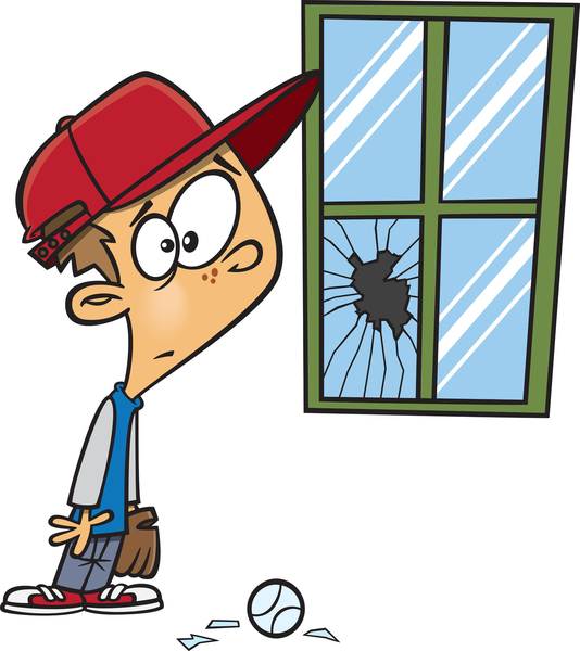 Guilty boy looking at broken window