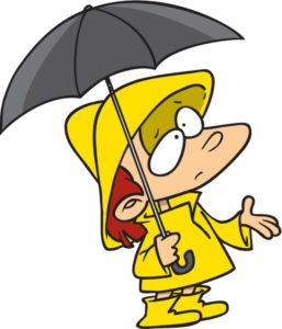 Boy holding umbrella and checking for rain